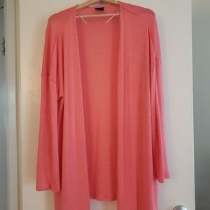 Oversized coral-colored cardigan